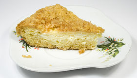Piece of a pie from cottage cheese. On a saucer Royalty Free Stock Image
