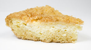 Piece of a pie from cottage cheese. On white stock photo