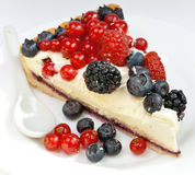 Piece of a pie with fresh berries Stock Image