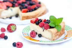 Piece of pie with fresh berries and mascarpone. Delicious pie with fresh summer berries and mascarpone cream Royalty Free Stock Image