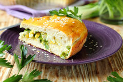 Piece of the pie with green onion on a plate Stock Photography