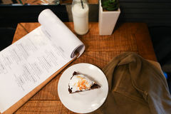 Piece pie, menu, glass bottle of milk, plant in vase and marsh d Stock Photos