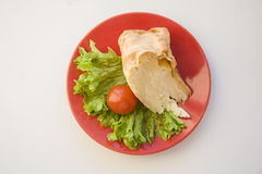 Piece of pie with tomatoon white background Stock Photography