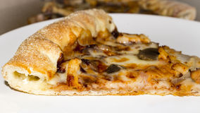 Piece of pizza with cheese edges Royalty Free Stock Photo