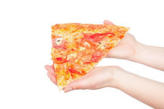 Piece of a pizza in giving hands Stock Image
