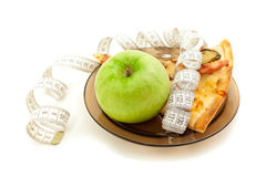 A piece of pizza and a green apple Royalty Free Stock Photos