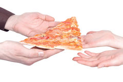 Piece of a pizza in the hands Stock Photography