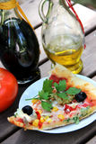 Piece of pizza in the summer garden table Stock Image
