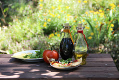 Piece of pizza in the summer garden table Stock Images