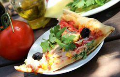 Piece of pizza in the summer garden table Stock Photos