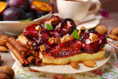 Piece of plum cake with nuts and spices Royalty Free Stock Photos