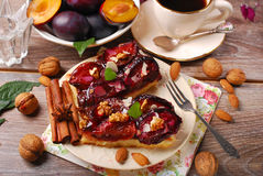 Piece of plum cake with nuts and spices Stock Photography