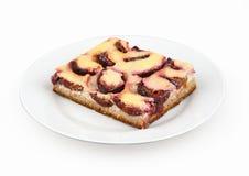 Piece of plum dessert Stock Image