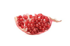 Piece of pomegranate. Piece of juicy red pomegranate on white background Royalty Free Stock Photography