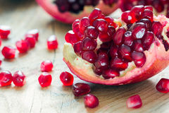 Piece of pomegranate Stock Images