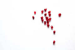 Piece of pomegranate on the white royalty free stock image