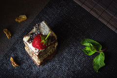 Piece of poppy seed cake with strawberry and mint Stock Image