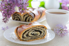 A piece of poppy seeds roll Stock Photography