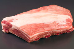 Piece of pork on a dark background Stock Images