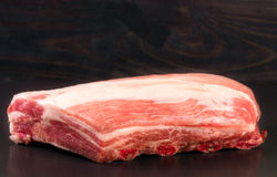 Piece of pork on a dark background Royalty Free Stock Images