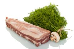 Piece of pork ribs, next to a bunch of dill and mushroom isolated on white. Background Stock Image