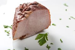 Piece of pork smoked ham with herbs Royalty Free Stock Photo
