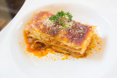 A Piece of pork and tuna Lasagna with parsley, close up Royalty Free Stock Photo