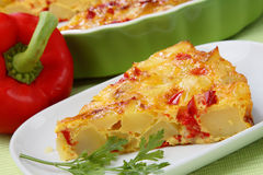 Piece of potato pie. With red pepper on plate Royalty Free Stock Photography