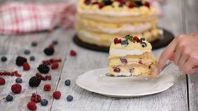 Piece of puff pastry cake with custard and currant berries, raspberries, blackberries. Delicious dessert. Piece of puff pastry cake with custard and currant stock video footage