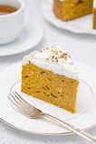 Piece of pumpkin cake with cream Royalty Free Stock Images