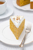 Piece of pumpkin cake with cream, selective focus Stock Photography