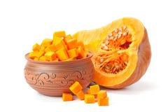A piece of pumpkin, pumpkin cubes in a clay pot Stock Photography