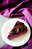 Piece of purple cake souffle black currants Royalty Free Stock Image