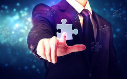 Piece of puzzle with businessman Stock Image