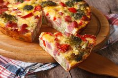 Piece of quiche with broccoli, pepper, bacon closeup Stock Photos