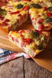 Piece of quiche with broccoli, pepper and bacon, vertical Royalty Free Stock Photography