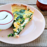 Piece of quiche with salmon and spinach Royalty Free Stock Images