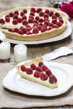 Piece of raspberry tart and big raspberry pie Royalty Free Stock Photography