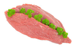 Piece of raw beef with parsley Royalty Free Stock Photography