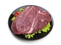 Piece of raw beef on plate isolated on white background. With clipping path Stock Photos