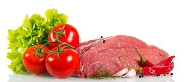 Piece of raw beef, tomato, mushrooms, lettuce, dill, garlic and. Pepper isolated on white background Stock Images
