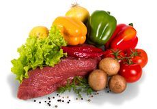 Piece of raw beef, tomato, mushrooms, lettuce, dill, onion, bulg. Arian and black pepper isolated on white background Stock Images