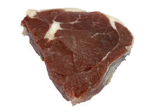 Piece of raw meat. Piece of the beef raw meat on a white background is isolated Stock Photo
