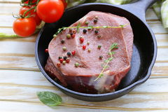 Piece of raw meat beef steak with spices. And herbs Stock Photography