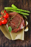 Piece of raw meat beef steak with spices. And herbs Royalty Free Stock Photo