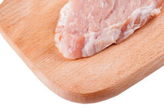 Piece of  raw meat pork on wooden board isolated closeup. Piece of fresh raw meat pork on a wooden Board Stock Photo