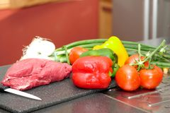 Piece of raw meat with vegetables. A piece of raw meat with vegetables Royalty Free Stock Photos