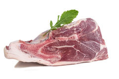 Piece of raw meat on a white with freshherbs. Piece of raw meat on a white background Stock Image