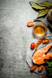 Piece of raw trout and tomatoes. Royalty Free Stock Image