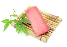 Piece raw tuna on bamboo plate Royalty Free Stock Photos